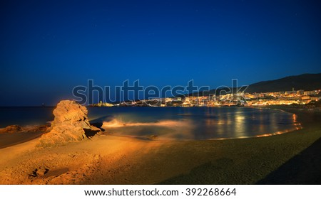 Picturesque Greek islands' town of Chora in Andros, Cyclades, viewed at dusk - stock photo