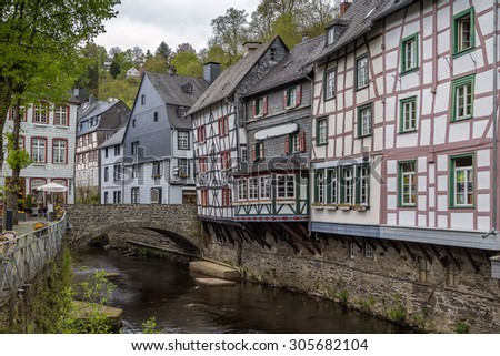 picturesque houses along the Rur River in the historic center of Monschau, Germany - stock photo
