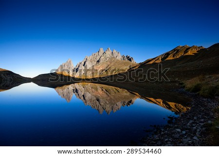 Picturesque lake in valley of Caucasus mountains in Georgia - stock photo