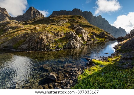 Picturesque lake in valley of Caucasus mountains in Georgia