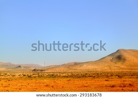 picturesque landscape in the desert of Morocco in the near of Tan Tan in West Sahara with sand dunes in the background - stock photo