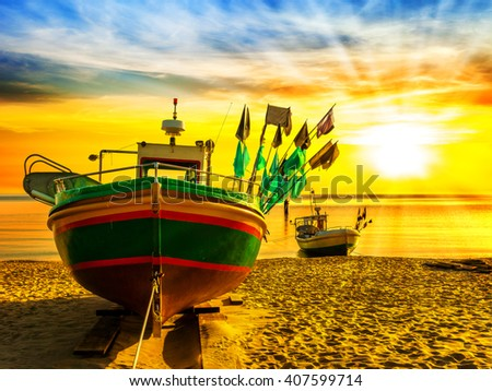 Picturesque landscape of a sunrise with a boat on beach in Sopot, Poland. - stock photo