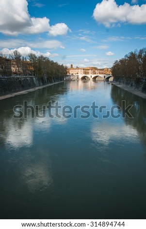 Picturesque landscape with an island on Tiber river, Rome, Italy