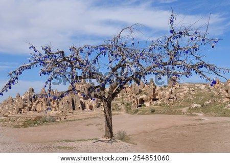 Picturesque landscape with  tree against the background of the sandy city, Cappadocia in Turkey. - stock photo