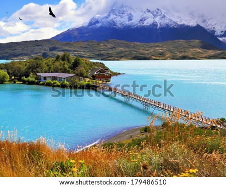 Picturesque little island in the lake Pehoe. Opened hotel on the island. Go to the hotel is an easy bridge. National Park Torres del Paine, Chile - stock photo