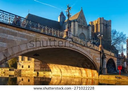 Picturesque medieval bridge and church of Saint Michael at sunrise in Ghent, Belgium - stock photo