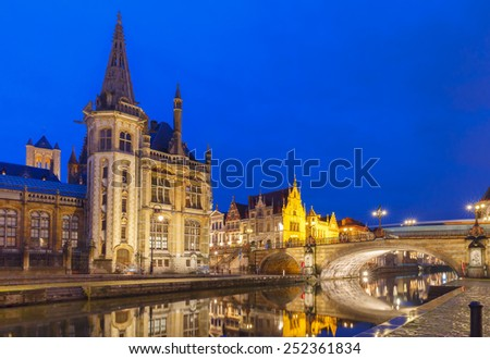 Picturesque medieval building and Post palace on the quay Graslei in Leie river at Ghent town night, Belgium - stock photo
