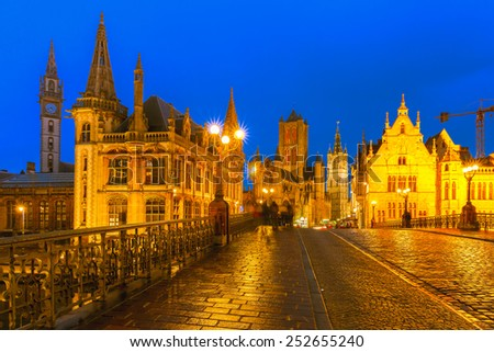 Picturesque medieval building and St. Michael's Bridge at sunset in Ghent, Belgium - stock photo