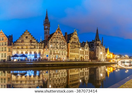 Picturesque medieval building and St Michael's Bridge on the quay Graslei in Leie river at Ghent town at evening, Belgium - stock photo
