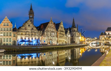 Picturesque medieval building and St Michael's Bridge on the quay Graslei in Leie river at Ghent town in the evening, Belgium - stock photo