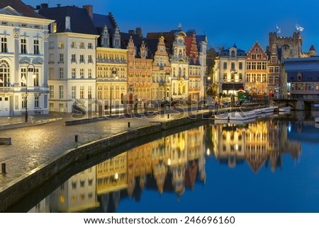 Picturesque medieval building on the quay Korenlei in Leie river at Ghent town at evening, Belgium - stock photo