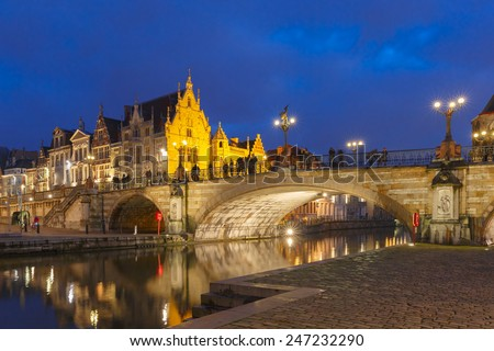 Picturesque medieval houses and St. Michael's Bridge at night in Ghent, Belgium