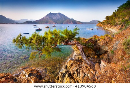 Picturesque Mediterranean seascape in Turkey. Sunny spring morning in Adrasan bay with view of Moses Mountain. Artistic style post processed photo. - stock photo