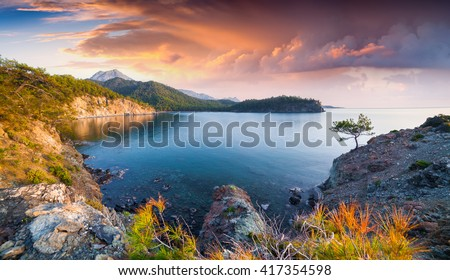 Picturesque Mediterranean seascape in Turkey. Sunrise in a small bay near the Tekirova village, District of Kemer, Antalya Province. Artistic style post processed photo. - stock photo