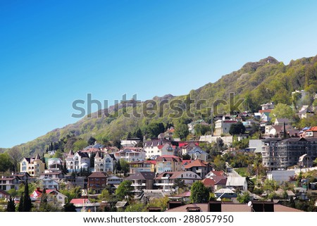 Picturesque mountain village in russia - stock photo