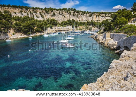 Picturesque narrow fjords between stony coast. White sailing yachts wait for the owners.  National Park Calanques on the Mediterranean coast - stock photo