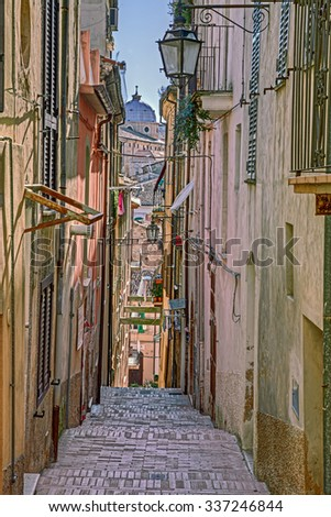 picturesque old narrow alley with stairway and cathedral on background in the ancient town Lanciano, Abruzzo, Italy