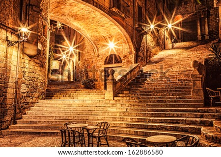 Picturesque old quarter of Girona at night. - stock photo