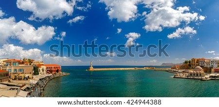 Picturesque panoramic view of old harbour of Chania with Lighthouse and Kucuk Hasan Pasha Mosque in the sunny day, Crete, Greece - stock photo