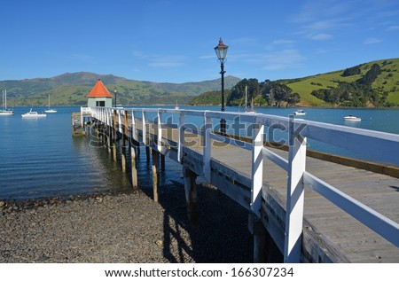 Picturesque pier on the foreshore of  the tourist town of Akaroa, Canterbury New Zealand.  - stock photo