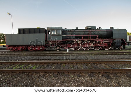 picturesque profile of a long vintage steam engine locomotive