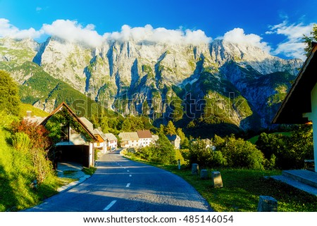picturesque road in beautiful alpine landscape with big mountains and small villages.
