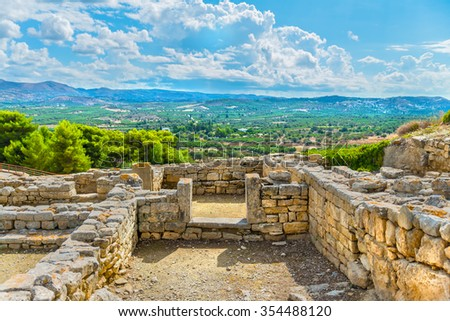Picturesque ruins of the ancient Minoan Palace of Phaistos( Festos )and beautiful plateau Messara and mountains in the backdrop.District of Heraklion.Crete island.Greece.Europe. - stock photo