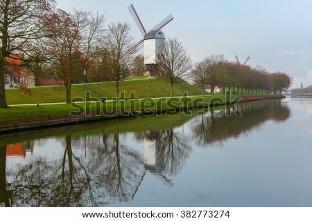 Picturesque rural landscape with Bonne Chiere Windmill and canal in Bruges, Belgium - stock photo
