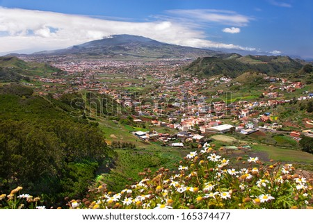 Picturesque, scenic landscape of mountain valley (dale) with blue sky, clouds and colorful houses (Tenerife, Canary islands, Spain). Travel concept. Outdoor.