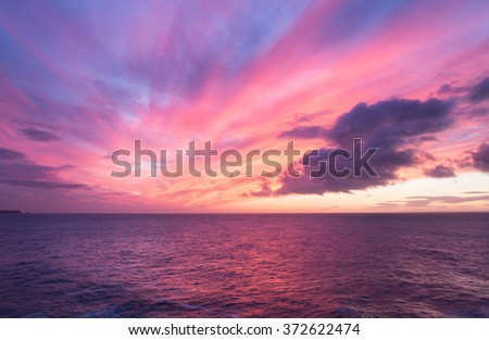 Picturesque sky at sunrise over the ocean - stock photo