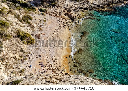 Picturesque small cove and lagoon of Cala Tao Ximo Beach in Benidorm city, view from the top. Cala Tao Ximo Beach is a popular destination for nudists. Costa Blanca. Spain - stock photo
