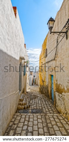 Picturesque small narrow street in Medina de Sousse, Tunisia, Africa - stock photo