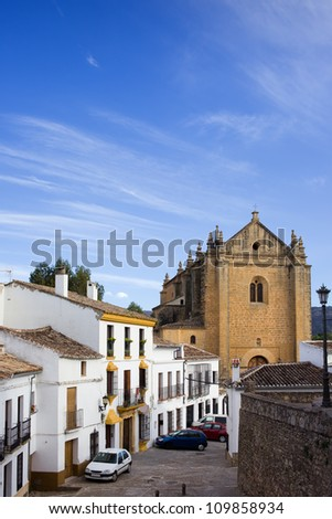 Picturesque street in the medieval old town of Ronda leading to the Church of the Holy Spirit, located in Spain, Andalusia region. - stock photo