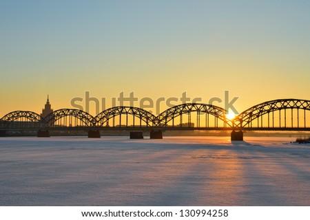 Picturesque sunrise over the Railway Bridge in Riga, Latvia - stock photo