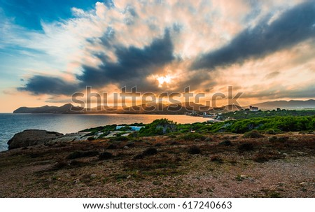 Picturesque sunset at coastline landscape, dramatic sky on Majorca island, Spain Mediterranean Sea.