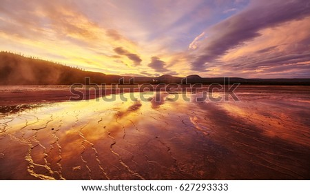 Picturesque sunset at Grand Prismatic Spring in Yellowstone National Park, Wyoming, USA.