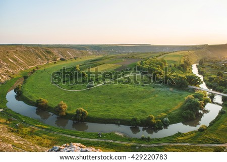 picturesque view from hill on river and meadow