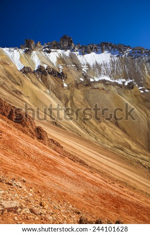 Picturesque view of colored mountain slopes near Salar de Uyuni in Bolivia - stock photo