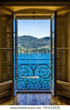 Picturesque view of Como lake through the doorway. Lombardy, Italy.