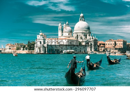 Picturesque view of Gondolas on Canal Grande with Basilica di Santa Maria della Salute in the background, Venice, Italy. Toning in cool tones