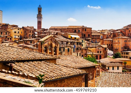 Picturesque view of many medieval houses in historical town of Siena, Tuscany province, Italy.