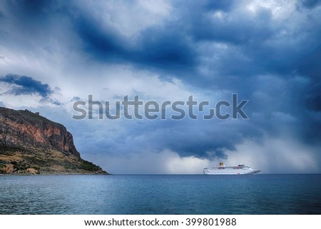 Picturesque view of the big cruise ship near the Greek Island Monemvasia. - stock photo