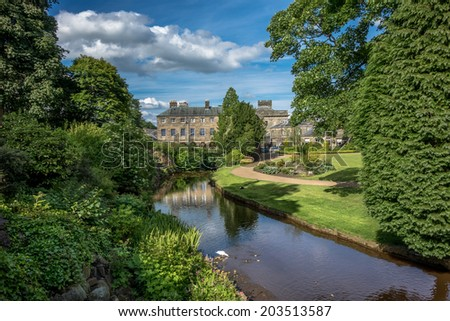 Picturesque view of typical stone buildings in Buxton from the park gardens.
