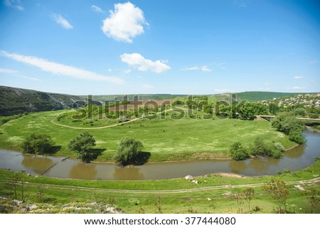 picturesque view on river and green fields