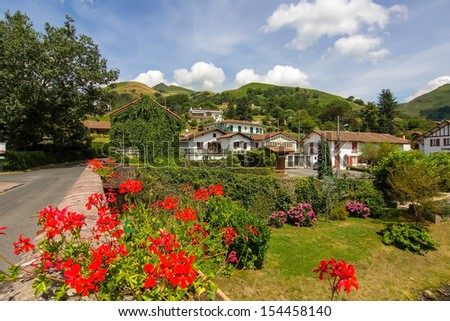 picturesque village in the South of France with many plants and a river - stock photo