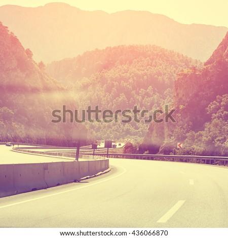 picturesque winding mountain highway. asphalt empty road - stock photo