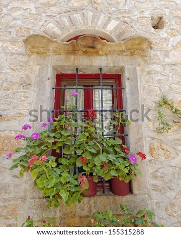 picturesque window and flowerpots, Greece