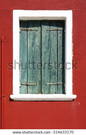 Picturesque windows on the famous island Burano, Venice, Italy