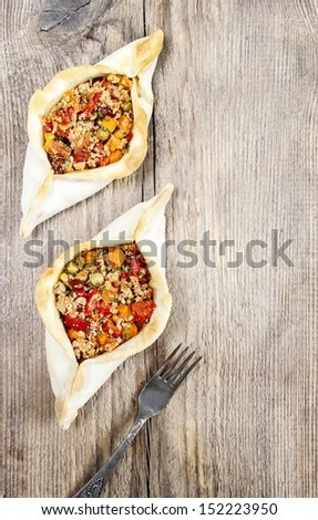 Pide, also known as Pita in some countries, is a dish similar to pizza, typically served as a part of Turkish, Armenian and Middle-Eastern cuisines. Copy space - stock photo