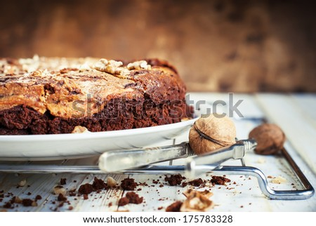 Pie Brownie from Chocolate and Cottage cheese  and Walnuts on Woodeb Table - stock photo